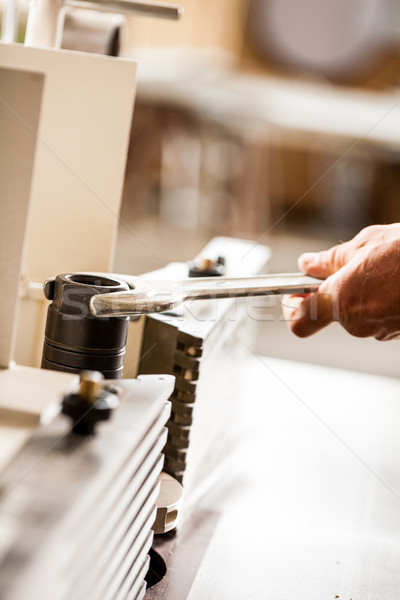Stock photo: hand of a woodworker setting up a milling cutter