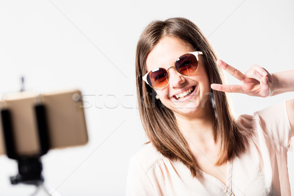 selfie woman with selfie stick and victory Stock photo © Giulio_Fornasar