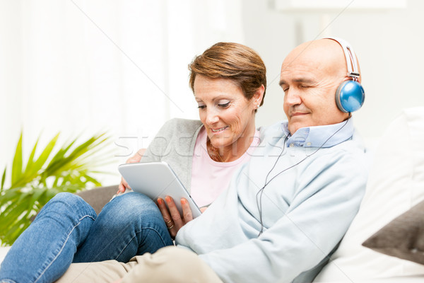 Contented married couple relaxing together at home Stock photo © Giulio_Fornasar