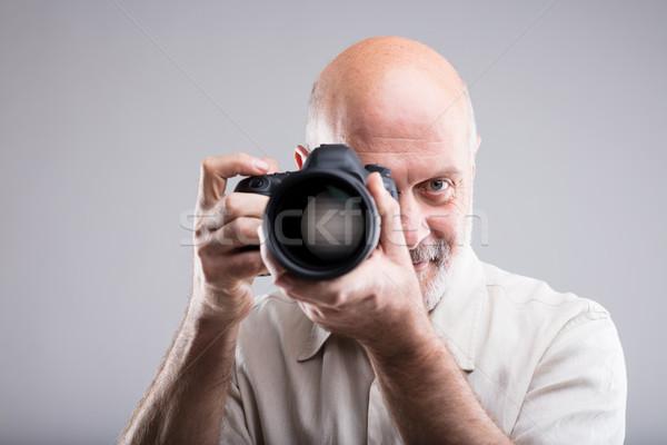 photographer draw a bead on camera Stock photo © Giulio_Fornasar