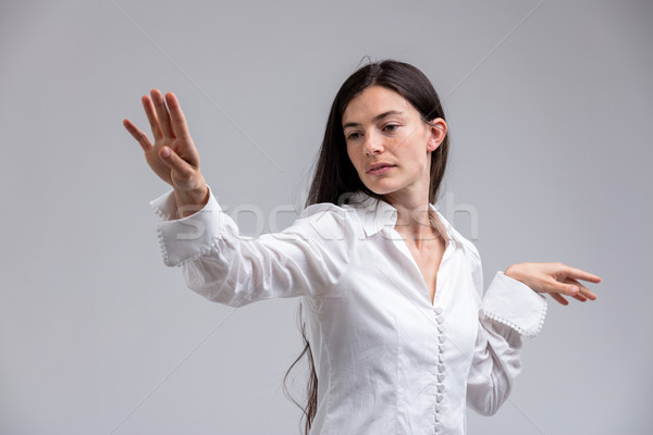 Imperious haughty woman flicking a hand in disdain Stock photo © Giulio_Fornasar