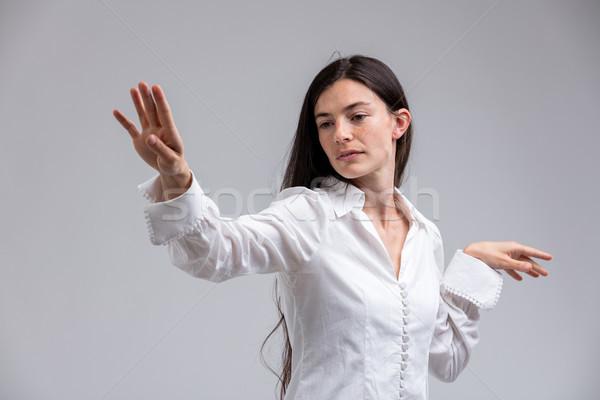 Nő kéz néz gúny izolált fehér Stock fotó © Giulio_Fornasar