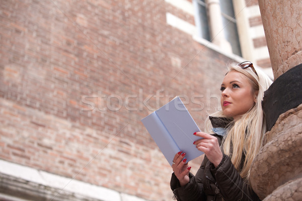 blonde young woman reading a book outdoors Stock photo © Giulio_Fornasar