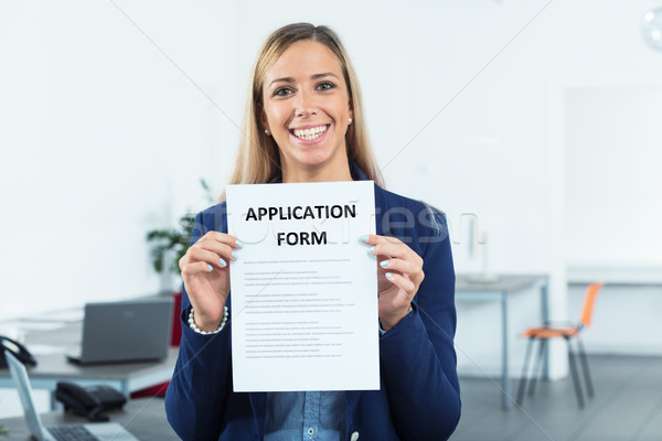 application form shown by woman Stock photo © Giulio_Fornasar