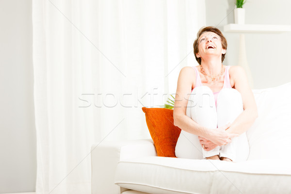 Attractive vivacious woman enjoying a laugh Stock photo © Giulio_Fornasar