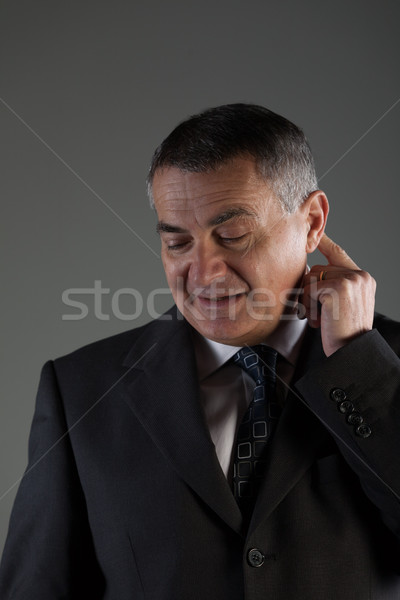 Thoughtful businessman scratching his ear Stock photo © Giulio_Fornasar