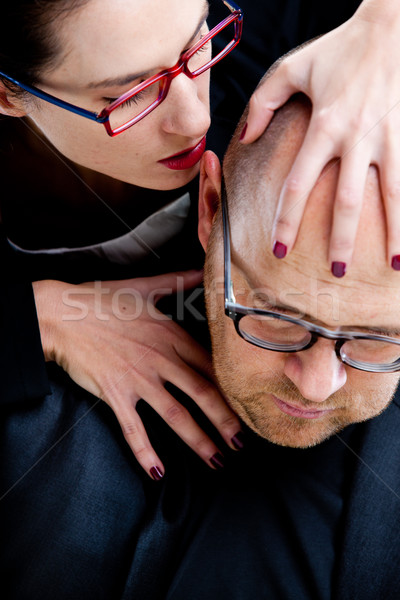 woman whispering nastily venom in man's ear Stock photo © Giulio_Fornasar