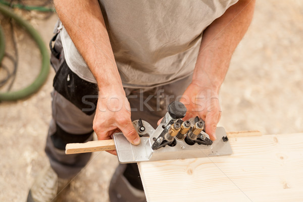 woodworker holding a jig on a wooden board Stock photo © Giulio_Fornasar
