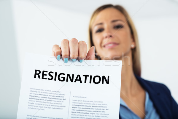 woman resigning with a smile on her face Stock photo © Giulio_Fornasar
