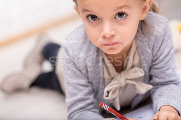 Thoughtful little girl staring with huge eyes Stock photo © Giulio_Fornasar