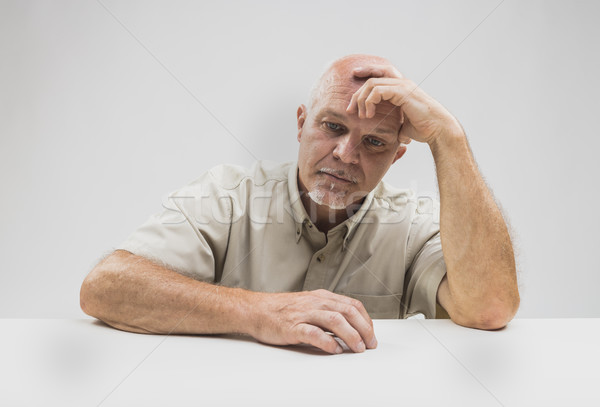 Despondent senior man sitting thinking Stock photo © Giulio_Fornasar