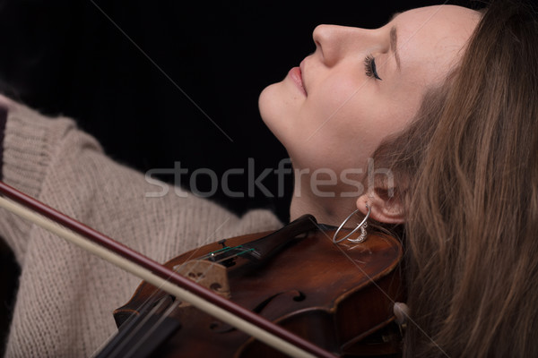 passionate violin musician playing on black background Stock photo © Giulio_Fornasar