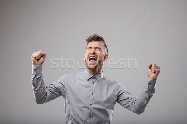 Elated man celebrating and cheering Stock photo © Giulio_Fornasar
