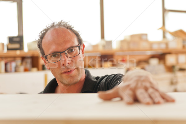 Stock photo: carpenter in his joiner