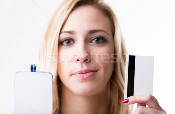 little gift packet on a smartphone and a girl with a credit card Stock photo © Giulio_Fornasar