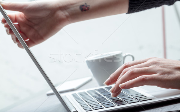 Businesswoman adjusting her screen height Stock photo © Giulio_Fornasar
