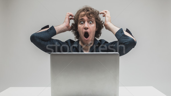 shocked man in front of his computer Stock photo © Giulio_Fornasar