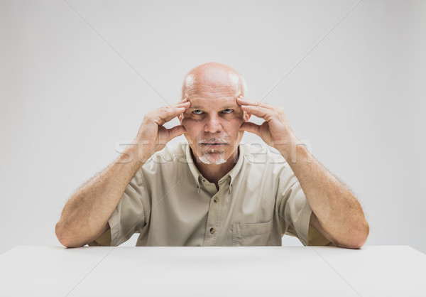 Contemplative balding man sitting at table Stock photo © Giulio_Fornasar