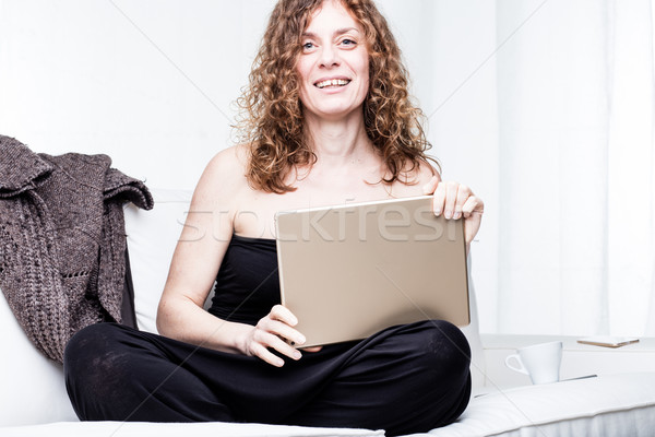 Happy pretty woman with computer and sweater Stock photo © Giulio_Fornasar