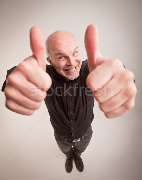 happy man and thumbs up in wideangle Stock photo © Giulio_Fornasar