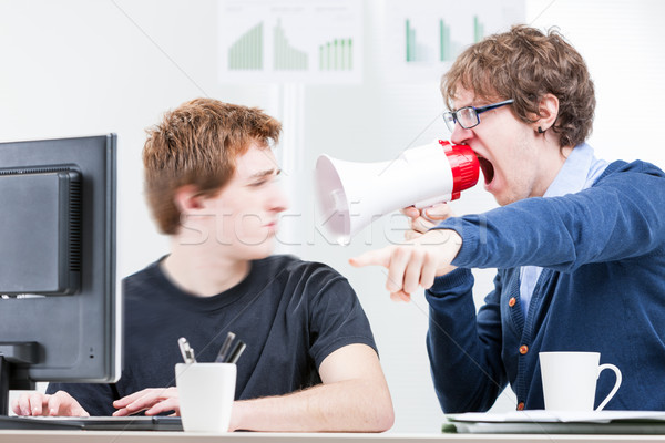 man shouting with a megaphone to his colleague Stock photo © Giulio_Fornasar