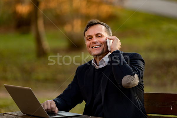senior man with laptop and mobile outdoors Stock photo © Giulio_Fornasar