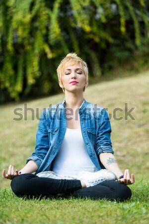 Meditáció lány park fiatal nő gyakorol zöld Stock fotó © Giulio_Fornasar