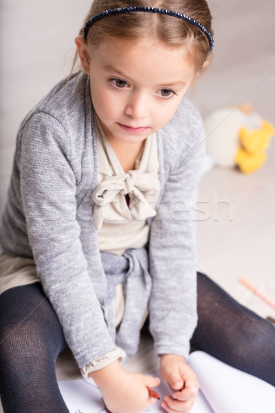 Pretty pensive little girl sitting on her bed Stock photo © Giulio_Fornasar