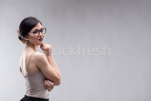 Beautiful woman looking over shoulder Stock photo © Giulio_Fornasar