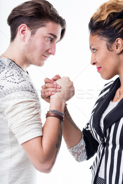 Man and woman facing off in a battle of wills Stock photo © Giulio_Fornasar