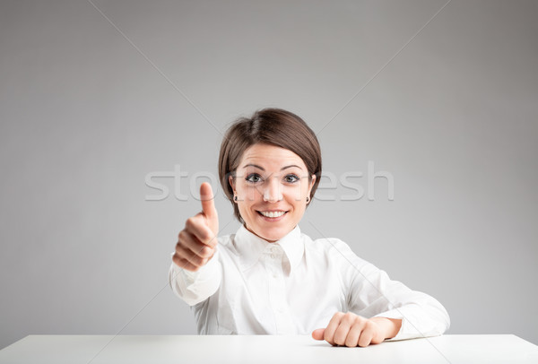 Excited woman making a thumbs up gesture Stock photo © Giulio_Fornasar