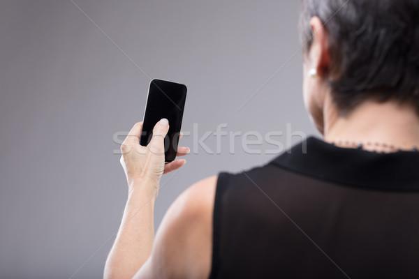 女性 黒 携帯電話 手 親指 ストックフォト © Giulio_Fornasar