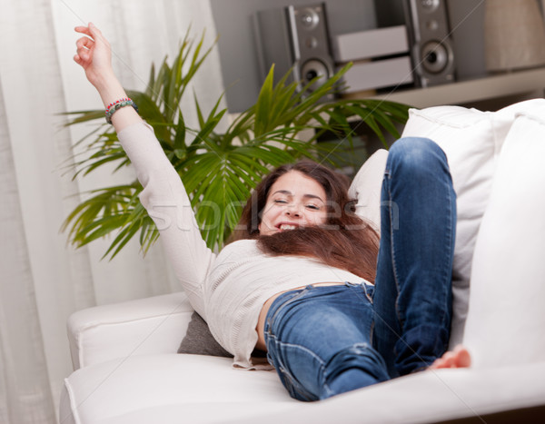 girl happily waking up on her sofa Stock photo © Giulio_Fornasar