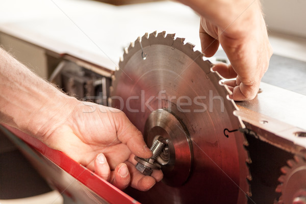 woodworker changing a sawblade by hand Stock photo © Giulio_Fornasar