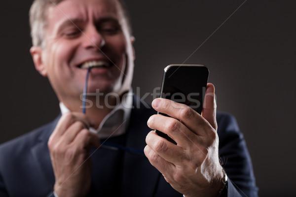 Dojrzały mężczyzna cyfrowe zawartość online zamazany Zdjęcia stock © Giulio_Fornasar