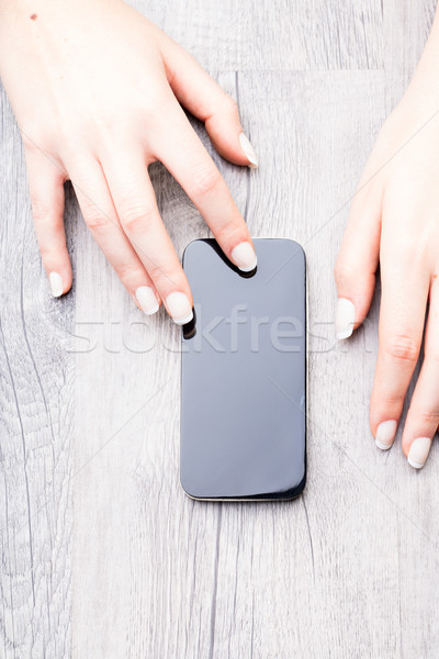 Hands of a woman with a modern mobile Stock photo © Giulio_Fornasar