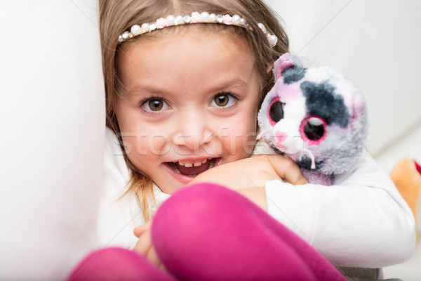 Cute laughing little girl with her fluffy toy Stock photo © Giulio_Fornasar