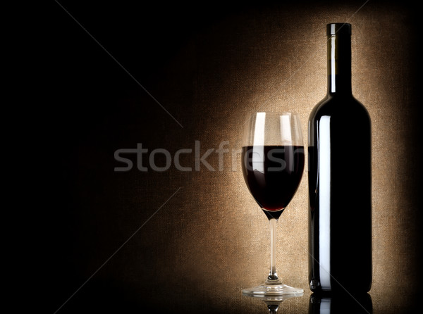 Wine bottle and wineglass on a old background Stock photo © Givaga