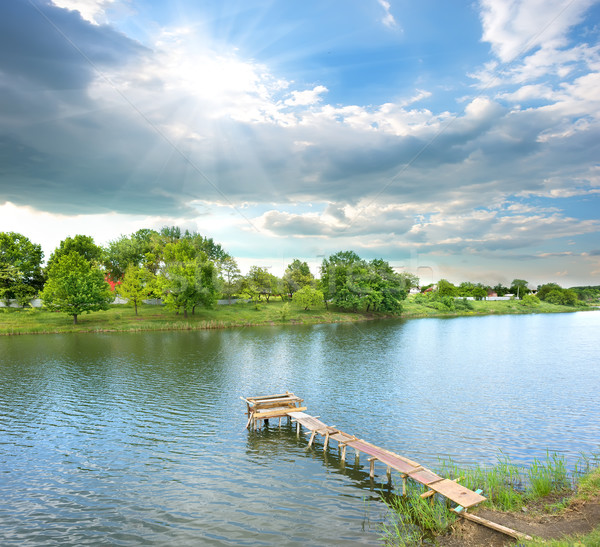 Fishing pier on the river Stock photo © Givaga
