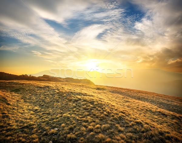 Mountains at sunset Stock photo © Givaga