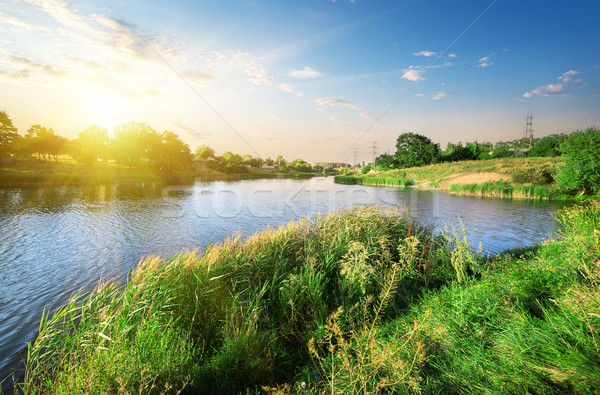 Bright sunset over river Stock photo © Givaga