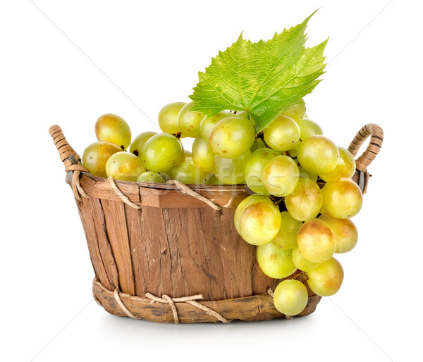 Grapes in a wooden basket isolated Stock photo © Givaga