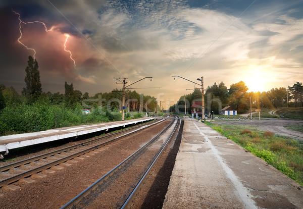 Slechte weer spoorweg onweerswolken zonsondergang landschap bomen Stockfoto © Givaga