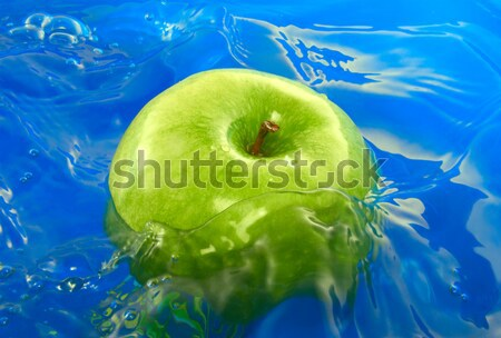 Green apple in water Stock photo © Givaga