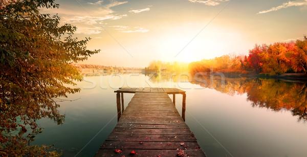 Kırmızı sonbahar balık tutma iskele ahşap nehir Stok fotoğraf © Givaga