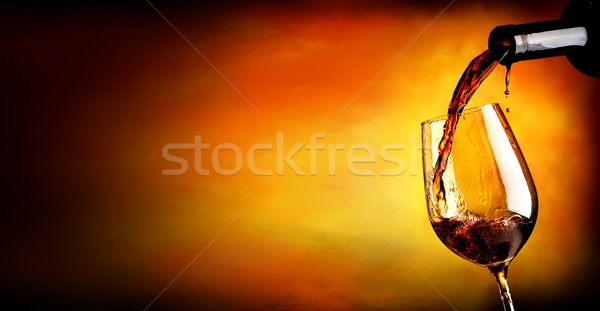 Pouring wine on orange Stock photo © Givaga