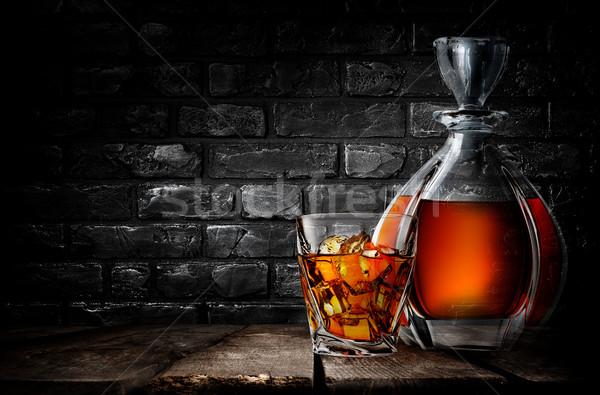 Whiskey and brick wall Stock photo © Givaga