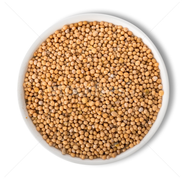 Mustard seeds in plate isolated Stock photo © Givaga