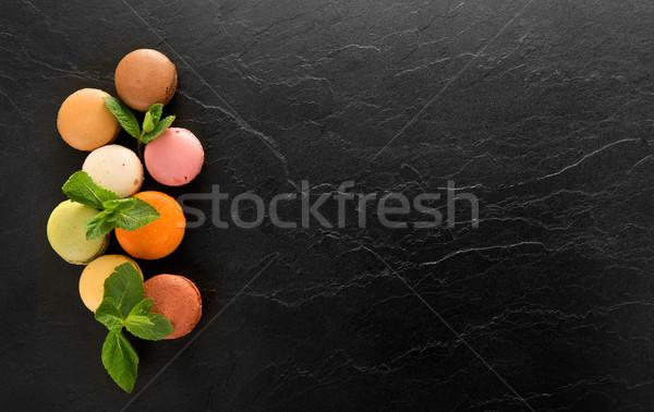 Macarons черный таблице красочный Sweet продовольствие Сток-фото © Givaga