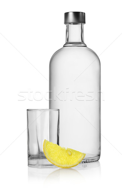 Bottle of vodka and lemon isolated Stock photo © Givaga